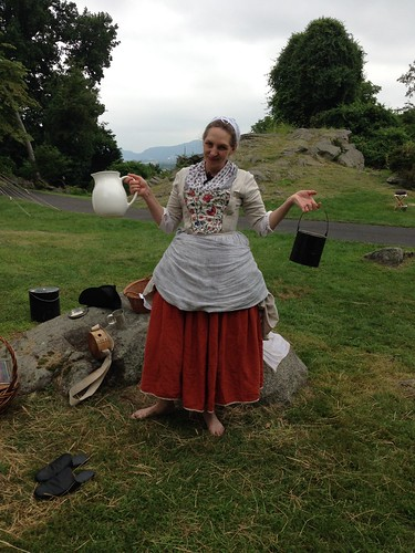 colonial woman with pitcher and kettle