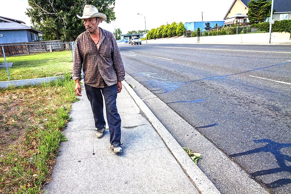 Walking-man-in-white-cowboy-hat-in-6-14--Pasco