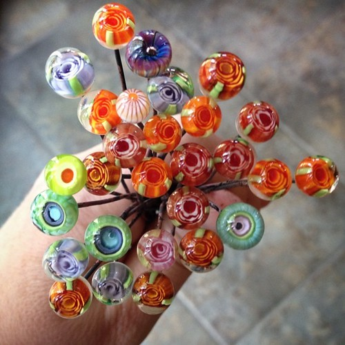 This morning's kiln harvest. Lots of flowers. Not too shabby for having to take lots of breaks. #lampwork #headpins #glassaddictions #beadfestphilly