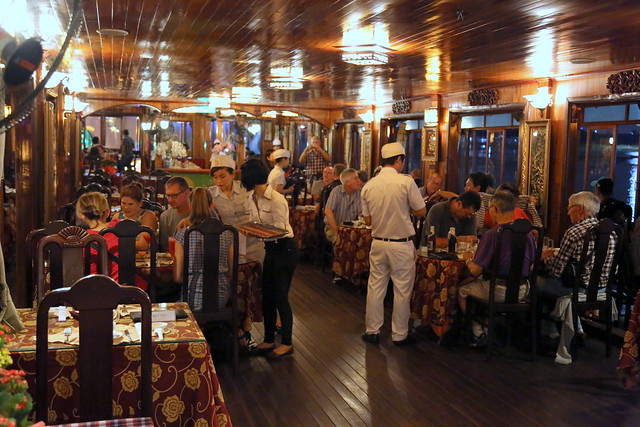 Saigon River dinner cruise in a dining cabin that has both Eastern and Western elements