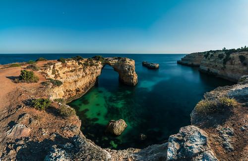 ocean travel blue sunset sea panorama praia beach portugal strand rocks meer arch sonnenuntergang turquoise cliffs atlantic algarve blau steep reise felsen bogen atlantik klippen türkies