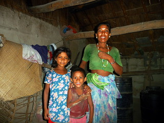 Ram Dwari with her younger daughter and son inside her home