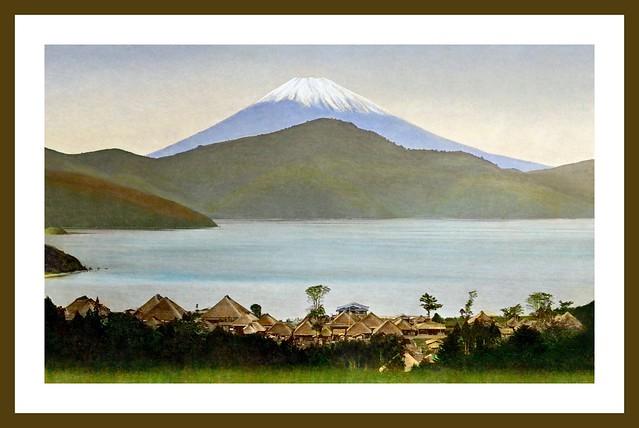 MT. FUJI RISING OVER LAKE ASHI AND HAKONE VILLAGE