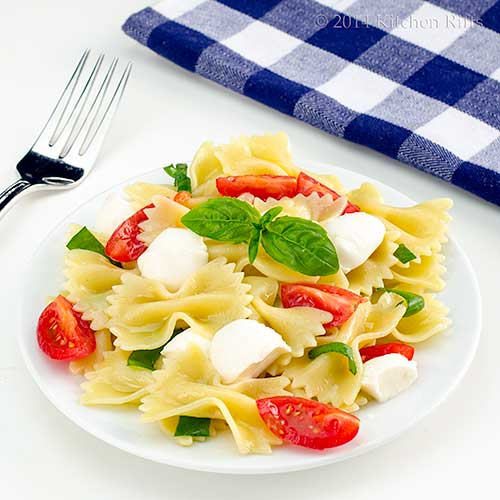 Pasta Caprese on plate with basil garnish