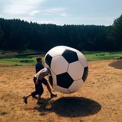 sport venue(0.0), baseball field(0.0), player(0.0), ball(1.0), sports(1.0), ball(1.0), football(1.0),