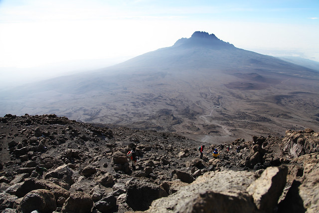 Students descend the mountain while taking in Mawenzi peak (Mt. Kilimanjaro, Tanzania)