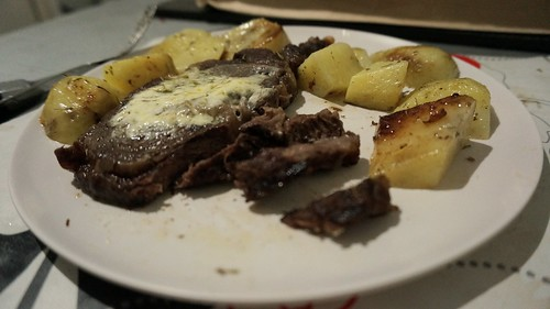 Steak and potatoes cooked in oven toaster