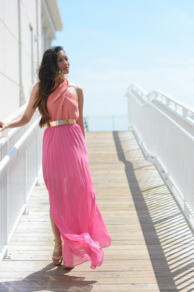 pink maxi dress with halter top and gold wide belt