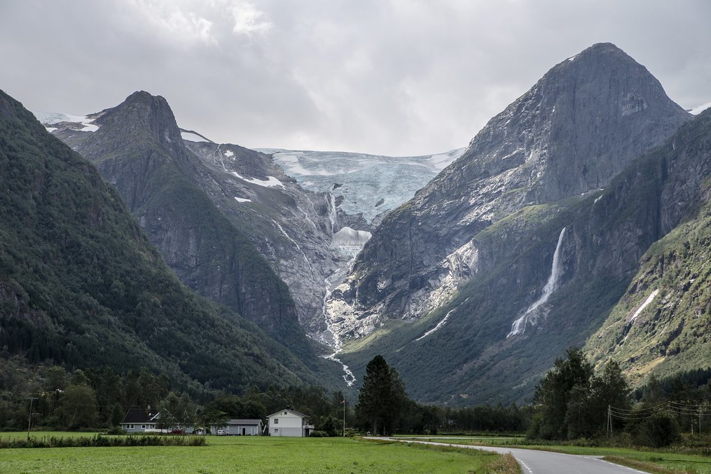 Branches of the Jostedalsbreen glacier reach down into the valleys. The glacier is maintained by the high snowfall rates in the region, not the cold temperatures. This means the glacier has high melting rates in its snouts. The Jostedalsbreen has around 50 glacier arms such as the pictured Briksdalsbreen near Olden.