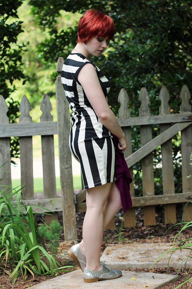 Black and White Bodycon Dress, Silver Shoes, and a Red Pixie Cut