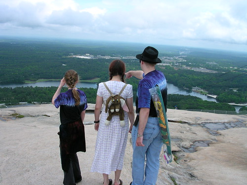 Oreta Sarah Taylor, Megan Tindale, and David Benedict look out over the grand vistas surrounding Stone Mountain.