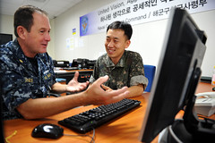 Republic of Korea Navy Lt. Bae, Jun-hee reviews scenario operational plans with Lt. Cmdr. Darrell Jones during Ulchi Freedom Guardian 2014. (U.S. Navy/MCC Wendy Wyman)