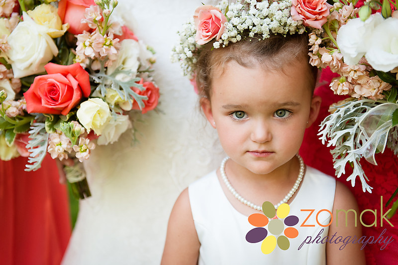 An adorable flower girl gets her moment in front of the camera.
