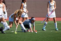 football player(0.0), tackle(0.0), women's lacrosse(0.0), football(0.0), stick and ball games(1.0), sports(1.0), competition event(1.0), team sport(1.0), hockey(1.0), field hockey(1.0), ball game(1.0), tournament(1.0), team(1.0),