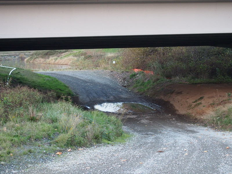 Frager Road's Remnants: From what I can tell, Frager Road used to continue from S 212th Street all the way to Southcenter Parkway, but levee work and other construction caused it to be truncated at S 212th Street.  The old ROW is now covered with gravel of varying quality, but is blocked off at all access points.