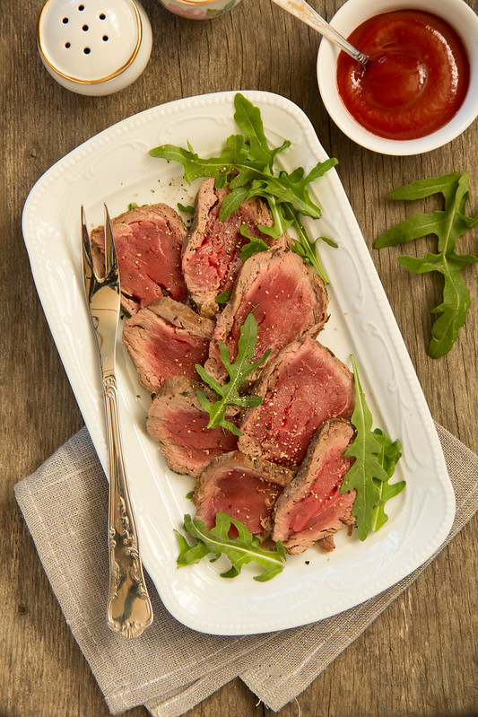 roast beef with salad of arugula and tomatoes.