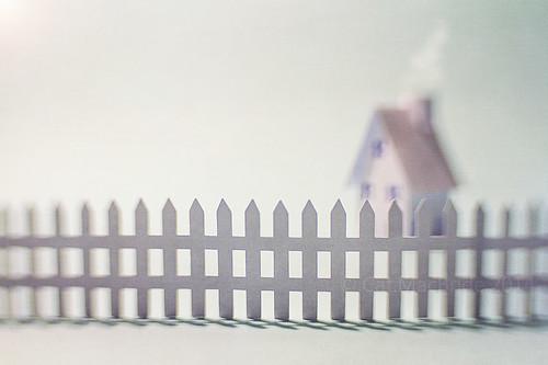 behind white picket fences...