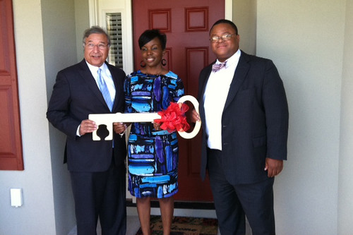 Tony Hernandez (left), Administrator for USDA Housing Programs, and Georgia Rural Development State Director Quinton Robinson congratulate Telisha Mack on her new home in recognition of National Homeownership Month.