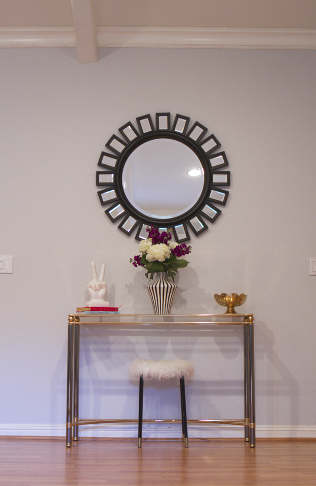 entryway brass console and starburst mirror