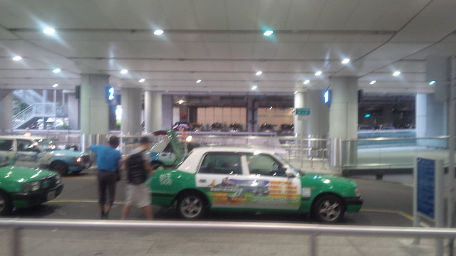 Nissan Leaf fleet charging at Hong Kong International, by the taxi rank