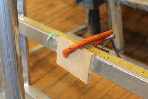Wooden stop block installed on the panel saw
