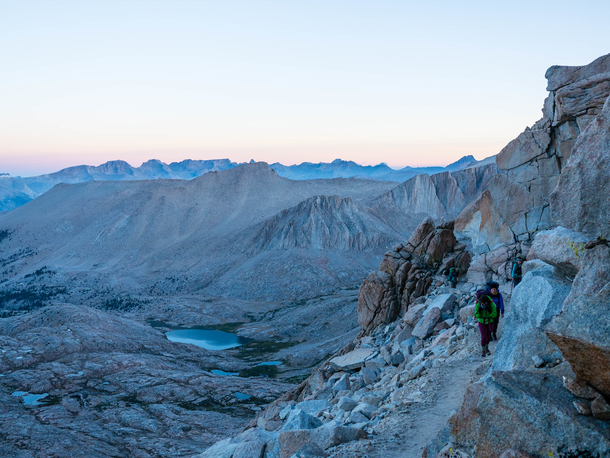 Hiking up towards Whitney as dawn sheds light on the Great Western Divide