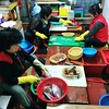 Getting our hoe (Korean raw fish) prepared at the market.