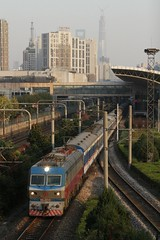 Electric locomotive SS7D 0016 departs Shanghai Railway Station with a rake of '25Z' class carriages