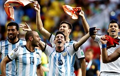 Argentina's forward and captain Lionel Messi (C) celebrates with teammates after winning the quarter-final football match between Argentina and Belgium at the Mane Garrincha National Stadium in Brasilia during the 2014 FIFA World Cup on July 5, 2014.    A