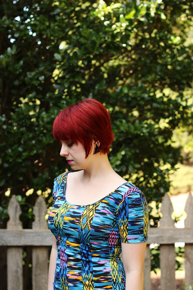 Short Red Hair, 80s Triangle Earrings, and an Abstract Print Dress