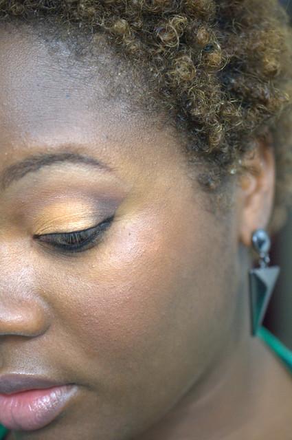 Orange eyeshadow on brown skin