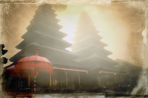Sunrise at a Bali temple with fog