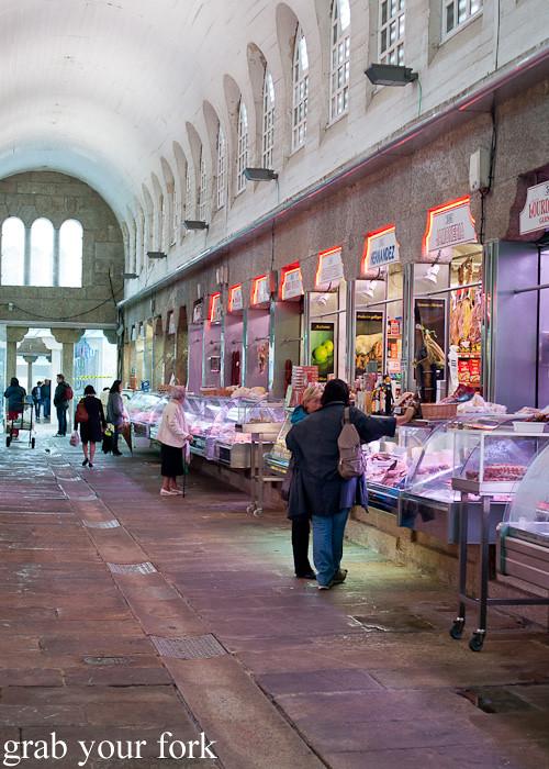 Shops inside Mercado de Abastos farmers market in Santiago de Compostela, Spain