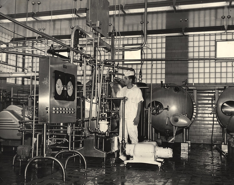 Man standing with a machine