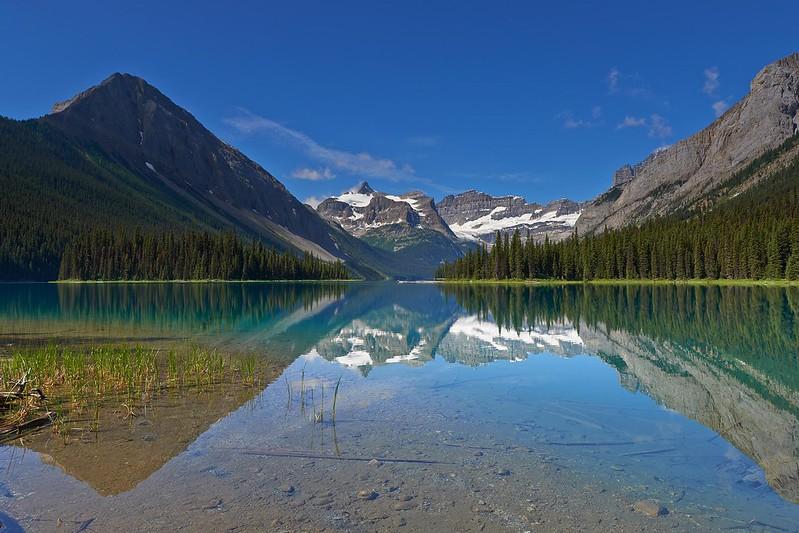 Mount Assiniboine reflecting in Marvel Lake - Mount Assiniboine Provincial Park