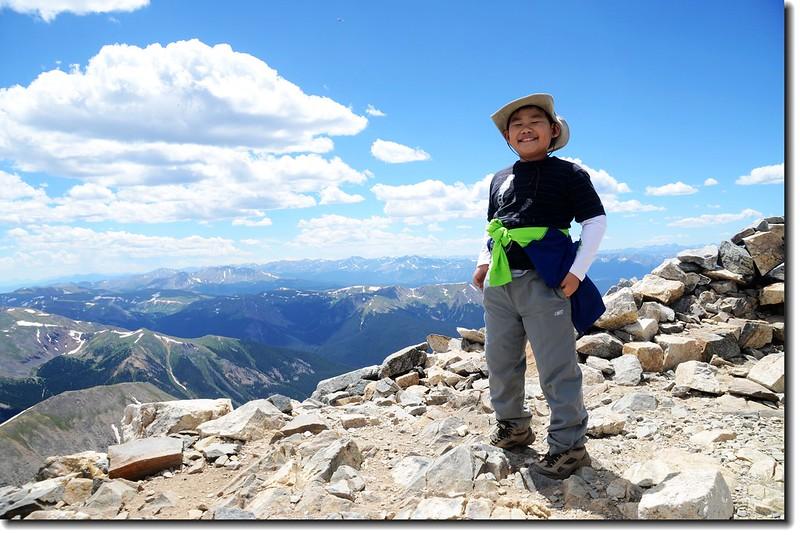 Jacob on the summit of Grays Peak's summit 3
