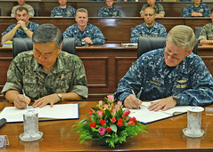 Vice Adm. Robert L. Thomas, commander of U.S. 7th Fleet and Vice Adm. Jung Ho-Sup, commander of the Republic of Korea Fleet, sign a charter pledging cooperation in anti-submarine warfare at the Naval Operations Base in Busan. (U.S. Navy/MC1 Frank L. Andrews)