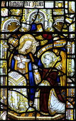 I. Annunciation: Mary at her prayer desk. Gabriel, crowned and haloed, with a sceptre of lilies, kneels in supplication.
