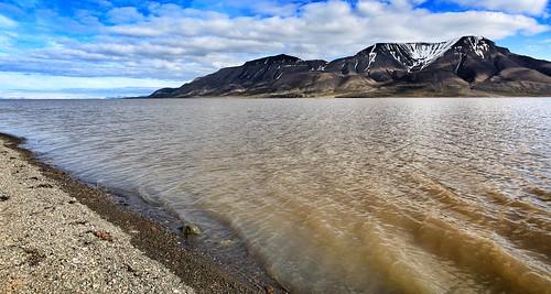 sea sky brown mountains clouds view shot best fiord longyearbyen svalbardcranebestviewnicelongyearbyennorwayfiordhillindustriallandscapebestshotseaoceancontainerscoalmineminers