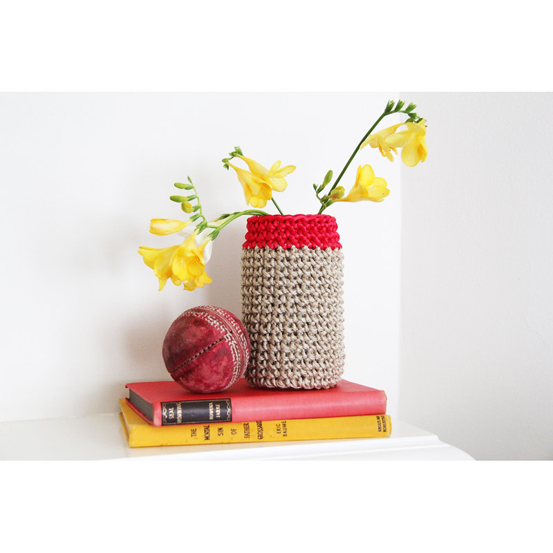 Covered jar with cherry red trim by Crayon Chick