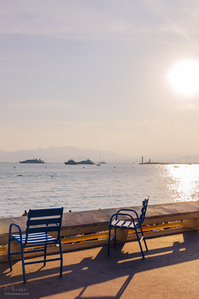 The typical blue chairs of the French Riviera seaside promenade