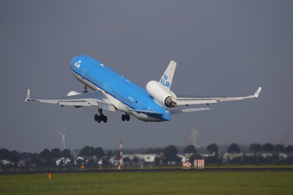 KLM MD-11 takes off in Schiphol towards Montreal