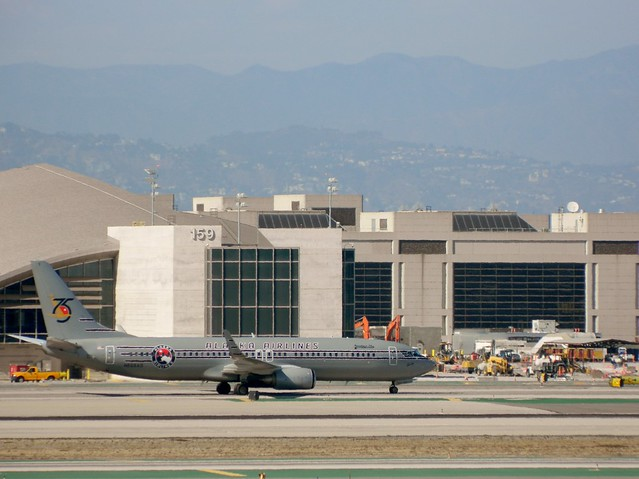 Alaska Airlines N569AS Boeing 737-890 special livery jet taxiing to the gate @ LAX on Saturday September 13, 2014.