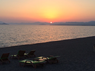 Image of Koca Çalış Plajı near Fethiye. sunset sky orange sun clouds canon colours rays