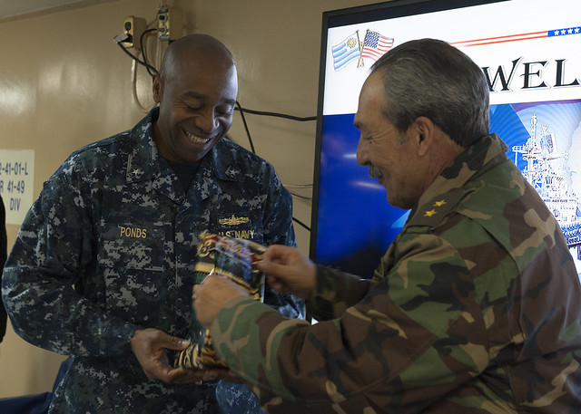 ATLANTIC OCEAN - Uruguay army Gen. Neris Corbo, right, presents a gift to Rear Adm. Frank L. Ponds, commander of Expeditionary Strike Group (ESG) 3, during a bilateral engagement with distinguished visitors from Uruguay aboard the future amphibious assault ship USS America (LHA 6).