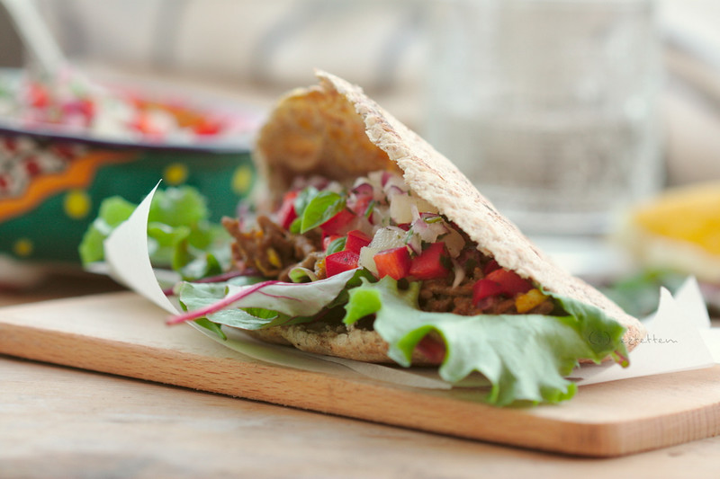 pita filled with spicy beef and pineapple salsa