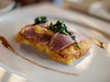 """""""Frico"""" soft cheese, smoked duck breast with potato, green onion & beet top confit"""