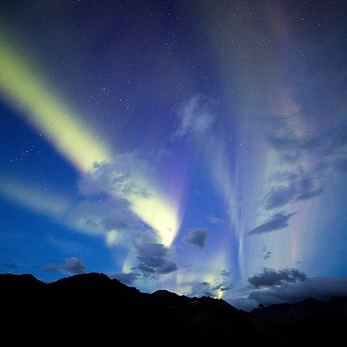 Welcome back Aurora! The clouds parted long enough in the Cathedral Mountains in Denali National Park last night for a few glimpses of the Northern Lights. Photo by Daniel A. Leifheit by usinterior