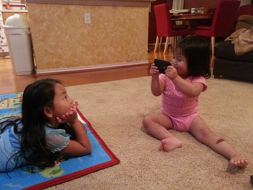 Dani pretending to take a video of Amelie.