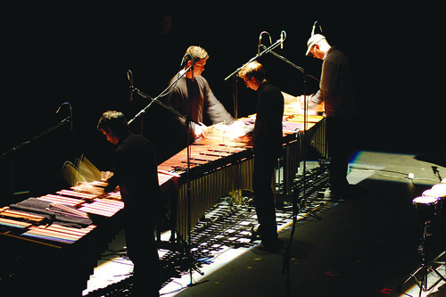 A percussion ensemble performs in the Butler School of Music. (Photo by Sally Mack)